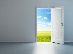 white empty room with open door