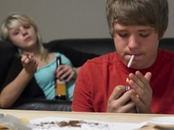 teenage,teenager,teen,drugs,couple,home,social issues,narcotics,smoking,joint,making,boy,girl,male,female,fifteen year old,sixteen year old,15 year old,16 year old,together,problem,indoors,horizontal,caucasian,drug abuse,cannabis,addiction,substance abuse,youth culture,two people
