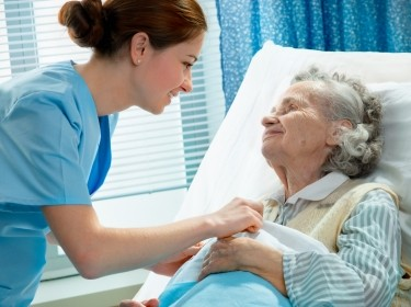 Nurse cares for an elderly woman