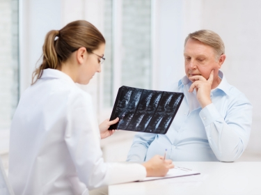 doctor with a senior patient reviewing an x-ray