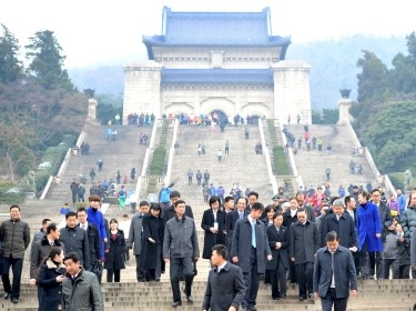 Taiwan's Mainland Affairs Minister Wang Yu-chi and his delegation leave after visiting the Sun Yat-sen mausoleum in Nanjing, Jiangsu province