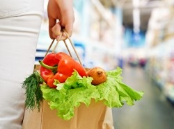 Woman holding a bag of groceries
