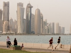 joggers and a family on the lakeside in Qatar