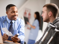 A doctor discussing a prescription with a patient