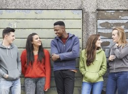 Teenagers hang out in an alley