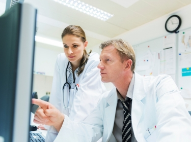 Two doctors looking at a patient's electronic medical records