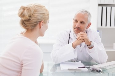 A doctor consults with his patient