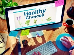 Person looking at a health choice website on a desktop computer