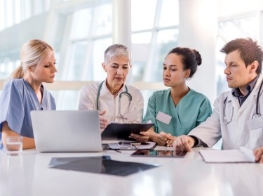 Medical staff discussing a patient's care