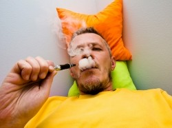 Man vaping while lying down