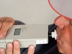 Man takes a breathalyzer test