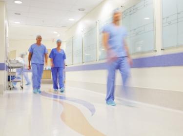 Nurses walking down a hospital hallway