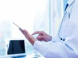 Doctor looking at medical record on a tablet