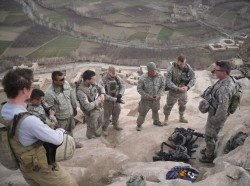Chaplain Mike Swartz performs a communion service at an outpost overlooking the Tangi Valley in Afghanistan February 20, 2010.