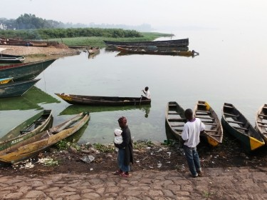 Ggaba, Uganda - June 30, 2011: Fishing boats line the banks of Lake Victoria after most fishermen have come in for the day.