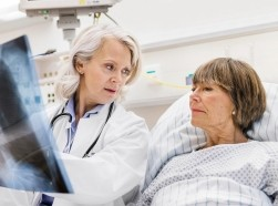 A doctor reviewing an x-ray with her patient