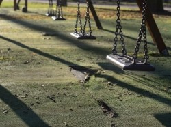 Close up of an empty swing set in a public park