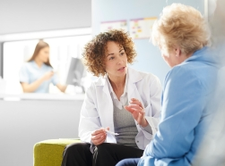 Female doctor discussing medication with a patient