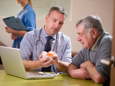 Doctor discussing a prescription with a patient, photo by sturti/Getty Images
