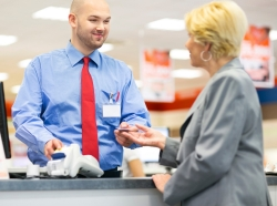 Woman paying a cashier with a credit card