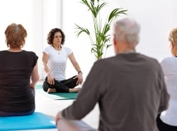 People in a seated meditation class