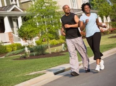 African American couple jogging on a neighborhood street