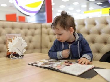 Kid with menu