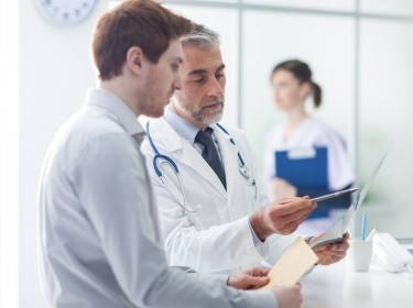 Doctor consulting with staff member