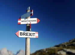 Brexit negotiations written on mountain road sign