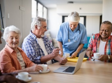 Nursing home residents having coffee