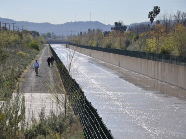 People walk alongside the Tujunga Wash urban stream in Los Angeles