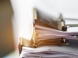 Stack of documents held with bulldog clip