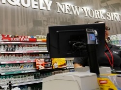 Cigarettes are displayed behind the counter of a convenience store in New York, March 18, 2013