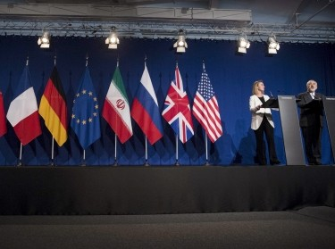 Iranian Foreign Minister Javad Zarif (R) makes a statement as European Union High Representative for Foreign Affairs and Security Policy Federica Mogherini watches, following nuclear talks at the Swiss Federal Institute of Technology in Lausanne, April 2, 2015.