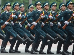 Vietnamese military members march during an honor guard ceremony at the Ministry of Defense in Hanoi, Vietnam