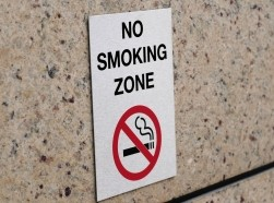 No Smoking Zone sign on a granite wall