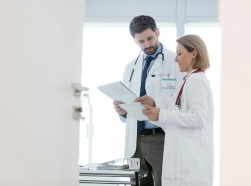 Male and female doctor having a discussion in an office