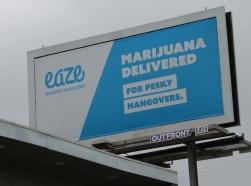 A billboard advertising marijuana delivery