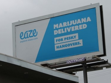 A billboard advertising marijuana delivery