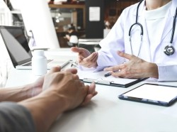 Close up of a doctor consulting with a patient