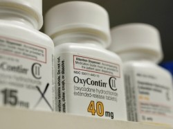Bottles of the prescription painkiller OxyContin sit on the shelves of a pharmacy in Provo, Utah, April 25, 2017