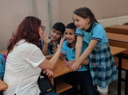 Italian MP Marietta Tidei talks with students at a school for vulnerable Syrian refugees in Gaziantep, Turkey