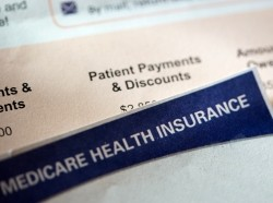 Close up of medical bill under Medicare health insurance letterhead, photo by Kameleon007/Getty Images