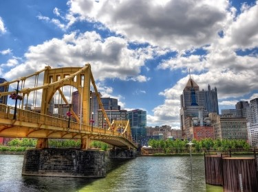 """Downtown Pittsburgh and the Allegheny River, photo by <a href=""""https://www.flickr.com/photos/zrfraileyphotography/6510707249"""">Zach Frailey</a> / <a href=""""https://creativecommons.org/licenses/by-nc-nd/2.0/"""">CC BY NC ND 2.0</a>/"""