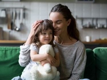 Happy mother hugging young daughter, photo by fizkes/Adobe Stock
