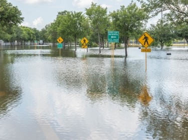 Flooded roads and landscapes in Houston, Texas following heavy rains, photo by Casey E Martin/Adobe Stock
