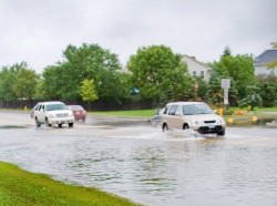 Traffic on flooded street, photo by Allkindza/Getty Images