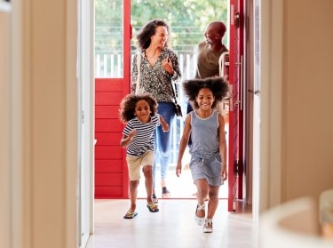Family returning home, opening front door, photo by Monkey Business Images/Adobe Stock