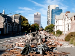 Rubble from earthquake damage in the street in Christchurch, New Zealand
