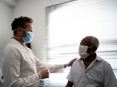Doctor examining an elderly man, photo by FG Trade/Getty Images